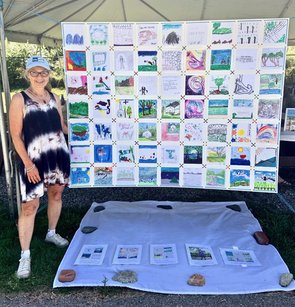 """Boston Harbor Islands Artist in Residence,""""Quilting the Islands Together"""" Robin with finished quilt. 56"""" x 72"""". Georges Island, Open Studios Event, August 24, 2019"""